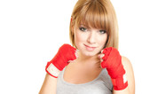 Portrait of beautiful red-haired girl in a glove Kickboxing