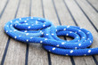 Blue sailing mooring line on the yacht teak wood