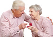 happy old couple with heart-shaped engagement ring