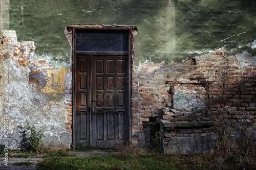 In de dag door and window of brick building