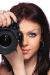 Woman with DSLR isolated