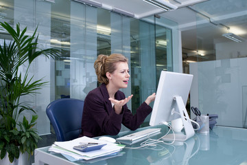 Stressed businesswoman at desk in office
