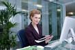 Smiling businesswoman at desk