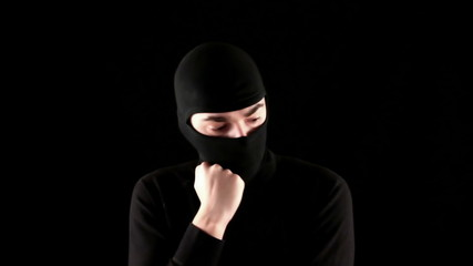 ninja thinks on black background