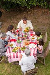 Family eating outside in the garden