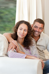 Couple sitting in their sofa