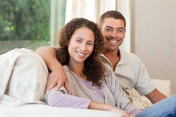 Joyful couple looking at the camera