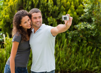 Couple taking a photo of themselves