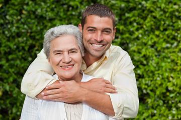 Man hugging his mother in the garden
