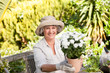 Senior woman with flowers in her garden