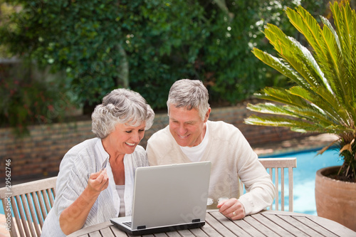 Retired couple buying something on internet
