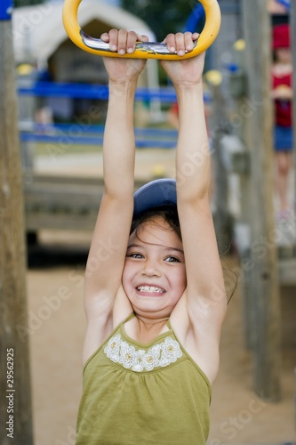 Girl Hanging From Playground Ride