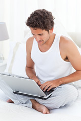 Man working on his laptop at home