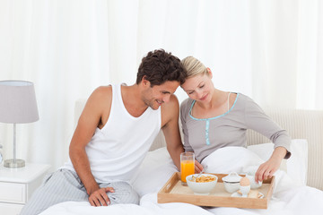 Lovers having breakfast at bed