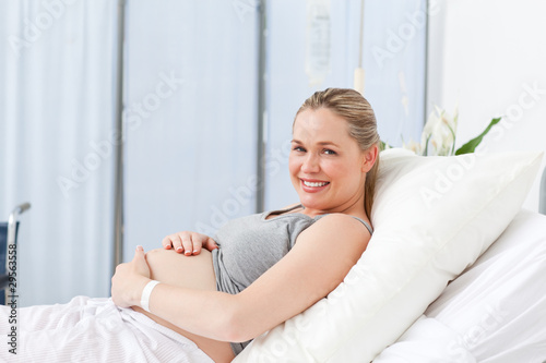 Pregnant young woman on a hospital bed