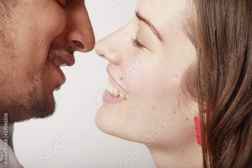 Profile Of A Couple About To Kiss