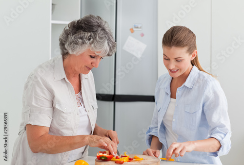 Woman cooking with her mother at home