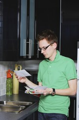 A Man Reading Envelope In The Kitchen