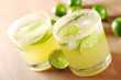 Fresh lemonade with lime slices and ice cubes