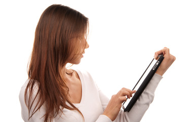Woman typing on her new electronic tablet touch pad computer