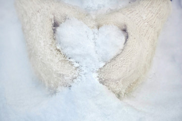 snow heart in mitten