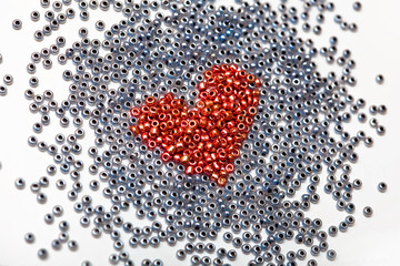 Background from beads with red hearts