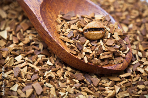 wood spoon of soluble coffee with coffee bean