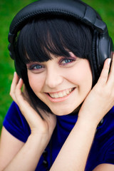 pretty young smiling woman listening music