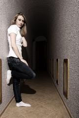 young girl posing in the  corridor