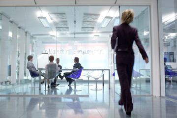 Businesswoman walking towards conference room