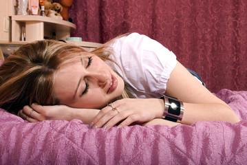 young girl sleeping  in her bedroom