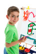 Young boy artist painting at easel
