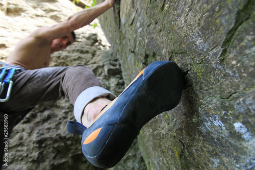 Rock climber preparing to climb