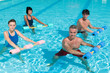 Fitness exercising in swimming pool