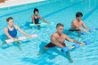 Aqua gym fitness exercise with water dumbbell
