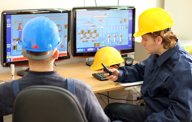 Two Workers in a Control room