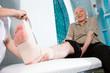 Senior man with hurted leg