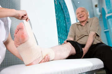 Senior man with hurted leg