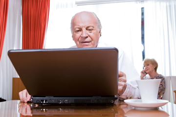 Senior using a laptop