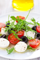 salad with mozzarella, tomatoes and black olive