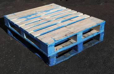 Two Blue Wooden Shipping Pallets On Tarmac