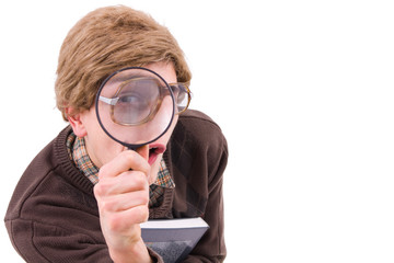 ner guy looking through a mganifyer