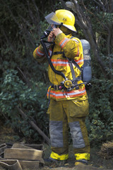 Fireman Putting On Equipment