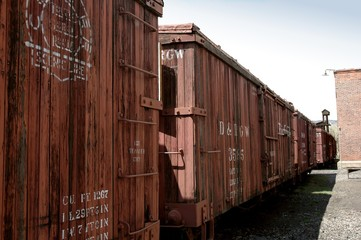 Narrow gauge, steam rail, wooden boxcars
