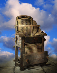 Electric Chair Against A Background Of Clouds