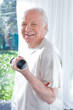 Senior man exercising with a dumbbell