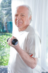 Funny old man performing exercises