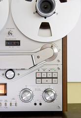 Vintage reel-to-reel tape recorder deck controls