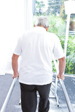 Back of a man trying to walk
