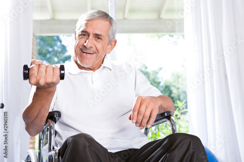 Happy old man trying to do sports